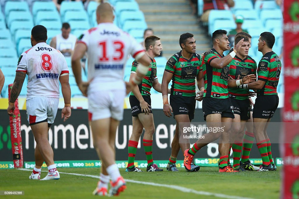 Kirisome Auvaa of the Rabbitohs celebrates with his team after scoring a try during the NRL Charity Shield match between the St George Illawarra Dragons and the South Sydney Rabbitohs at ANZ Stadium on February 13, 2016 in Sydney, Australia.