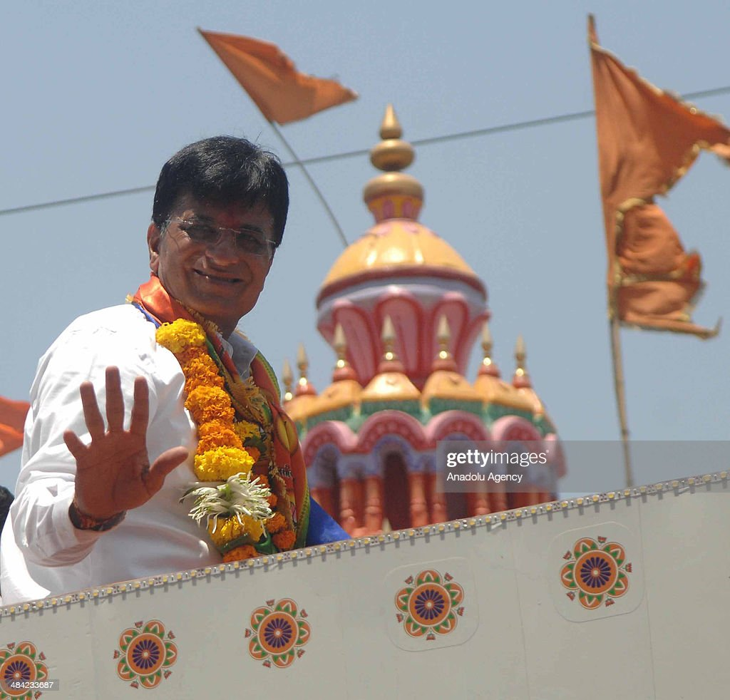 Kirit Somaiya, leader of Bharatiya Janata Party and contestant from Mumbai's northeast constituency campaigns in Mankhurd, an eastern Mumbai suburb, greets the crowd on April 11, 2014 in Mumbai, India.