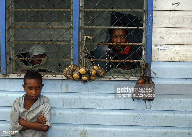 A Kiriwina Islander child guards a bundle of live crabs bound for the cooking pot in the Trobriand Islands of Papua New Guinea 13 August 2007...