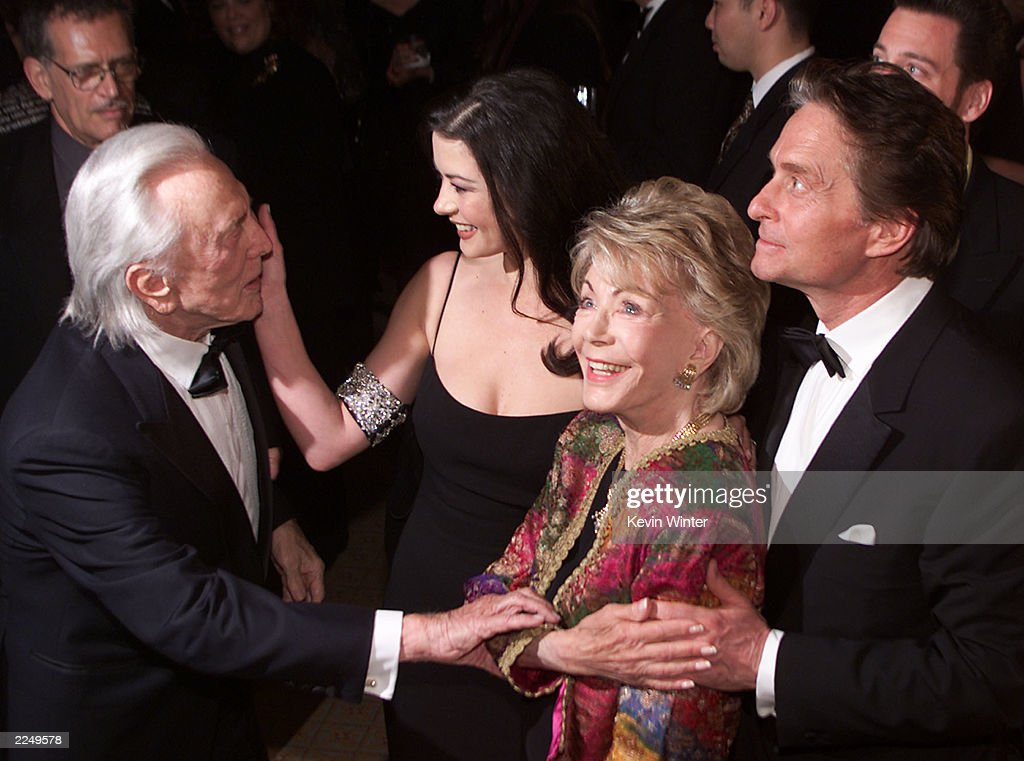 Kirk and Anne Douglas, Catherine Zeta-Jones and Michael Douglas at 'An Unforgettable Evening', sponsored by Saks Fifth Avenue to benefit Ceders-Sinai Medical Center at the Regent Beverly Wilshire Hotel, Beverly Hills, Ca. 3/27/01. Catherine Zeta-Jones and Michael Douglas are the first couple to receive 'The Courage Award'. Sting performed live at the event. Los Angeles. Photo by Kevin Winter/Getty Images.