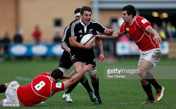 Kirk Baker of New Zealand Maori All Blacks is tackled by Ben Pienaar and Charlie Hayter of the RFU Championship XV during the RFU Championship XV and...