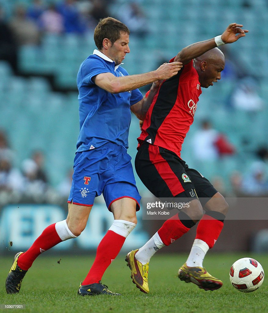 Kirk Broadfoot of Rangers completes for the ball with El Hadji Diof of the Rovers during the pre-season friendly match between Blackburn Rovers and Glasgow Rangers at the Sydney Football Stadium on July 25, 2010 in Sydney, Australia.