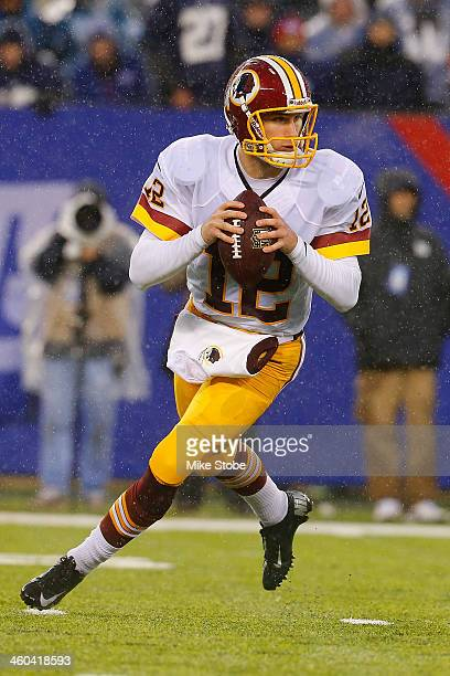 Kirk Cousins of the Washington Redskins in action against the New York Giants at MetLife Stadium on December 29 2013 in East Rutherford New Jersey...