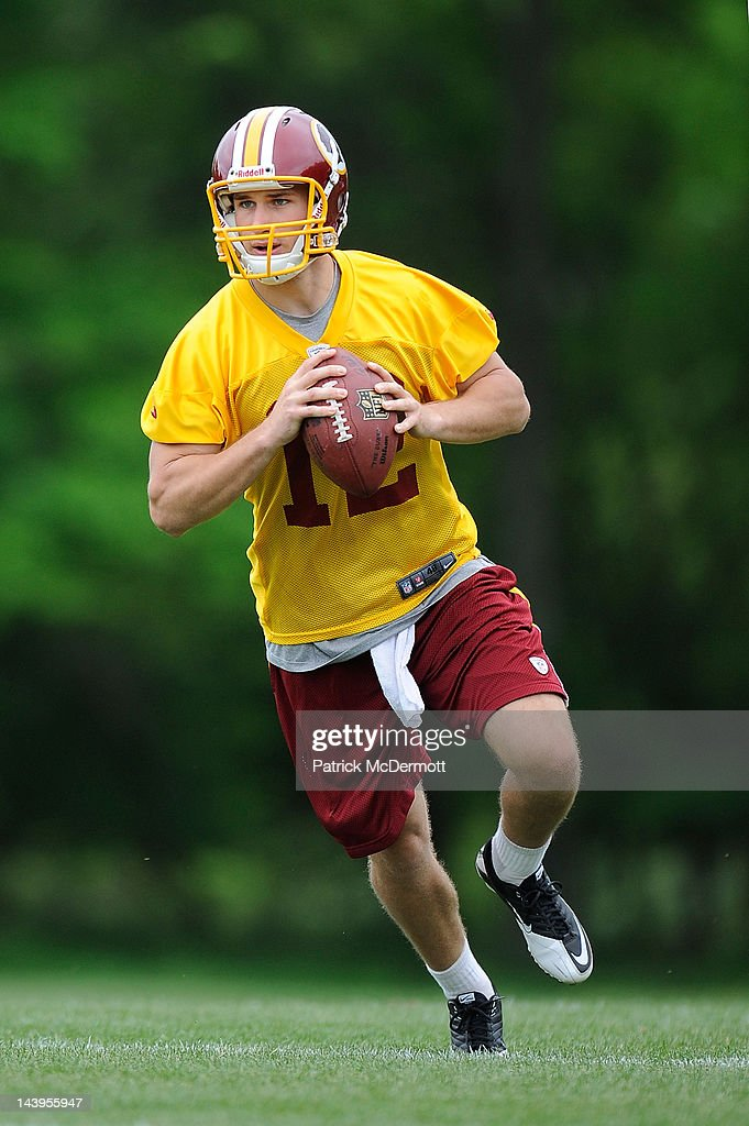 Kirk Cousins #12 of the Washington Redskins practices during the Washington Redskins rookie minicamp on May 6, 2012 in Ashburn, Virginia.