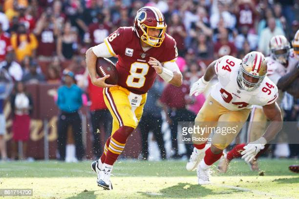 Kirk Cousins of the Washington Redskins runs the ball for a sevenyard touchdown in the fourth quarter of a game against the San Francisco 49ers at...