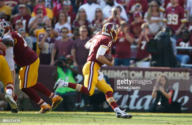 Kirk Cousins of the Washington Redskins rushes for a 7yard touchdown during the game against the San Francisco 49ers at FedEx Field on October 15...
