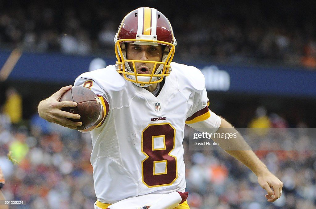 Kirk Cousins of the Washington Redskins scores a touchdown during the first quarter against the Chicago Bears on December 13 2015 at Soldier Field in...