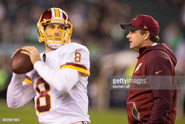 Kirk Cousins of the Washington Redskins warms up as head coach Jay Gruden walks past him prior to the game against the Philadelphia Eagles on...