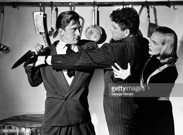 Kirk Douglas Burt Lancaster and Lizabeth Scott is a scene from the Paramount Picture I Walk Alone Directed by Byron Haskin
