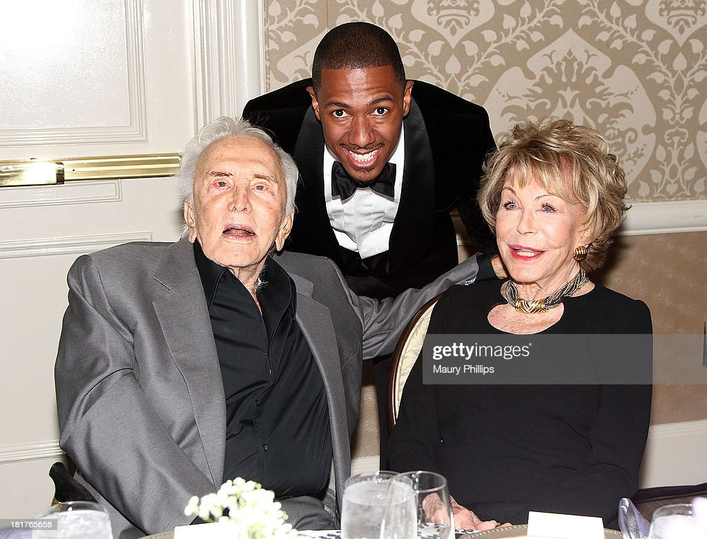 Kirk Douglas, Nick Cannon and Anne Douglas attend The Los Angeles Mission and Anne Douglas Center for Women Gala at Four Seasons Hotel Los Angeles at Beverly Hills on September 24, 2013 in Beverly Hills, California.