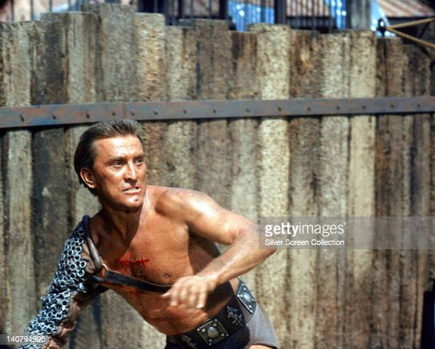 Kirk Douglas US actor wearing chain mail protection on his right arm in a publicity still issued for the film 'Spartacus' 1960 The historical drama...