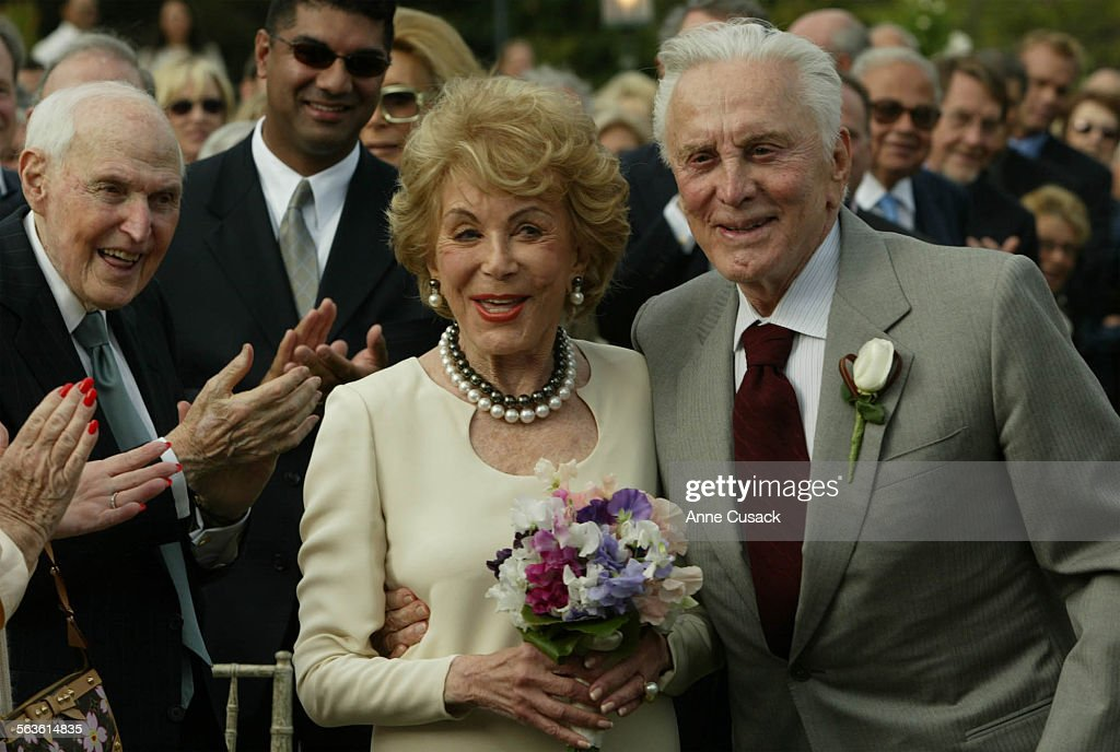 Kirk Douglas with his bride Anne walk down the isle to say their vows again after 50 years of marriageAnne and Kirk Douglas celebrated their 50th...