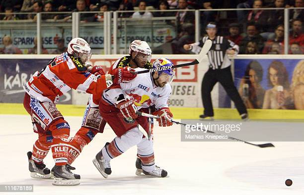 Kirk Furey and Sean Brown of KAC fight with Manuel Latusa of Salzburg during the EHL match between EC KAC and Red Bull Salzburg at Stadthalle...