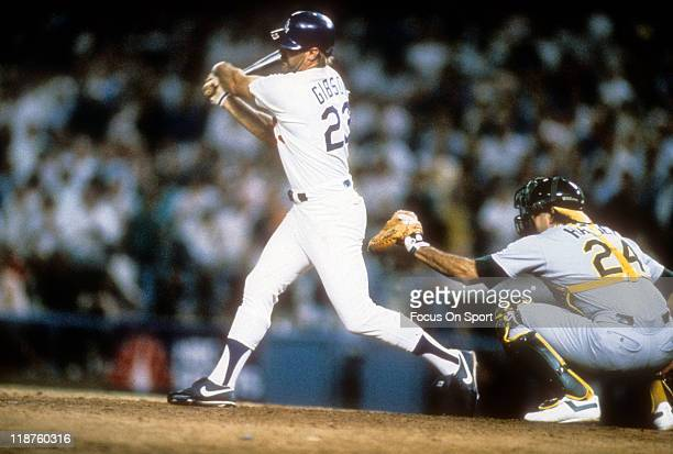 Kirk Gibson of the Los Angeles Dodgers bats in the bottom of the ninth inning of game one against the Oakland Athletics during the 1988 World Series...