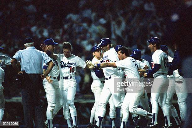 Kirk Gibson of the Los Angeles Dodgers celebrates his winning home run hit in the bottom of the ninth inning during game one of the 1988 World Series...