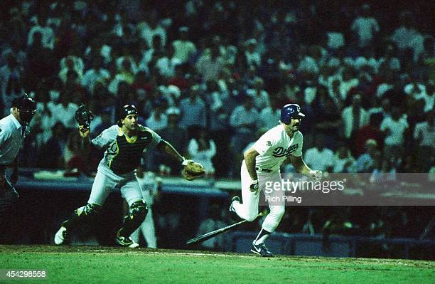 Kirk Gibson of the Los Angeles Dodgers hits in the bottom of the ninth inning during World Series game one against the Oakland Athletics on October...