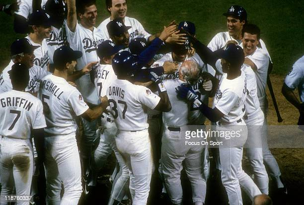 Kirk Gibson of the Los Angeles Dodgers is mobbed by teammates after he hit a pitch hit home run in the bottom of the 9th inning off of relief pitcher...