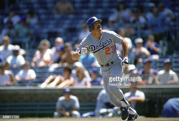 Kirk Gibson of the Los Angeles Dodgers runs the bases against the Chicago Cubs during an Major League Baseball game circa 1988 at Wrigley Field in...
