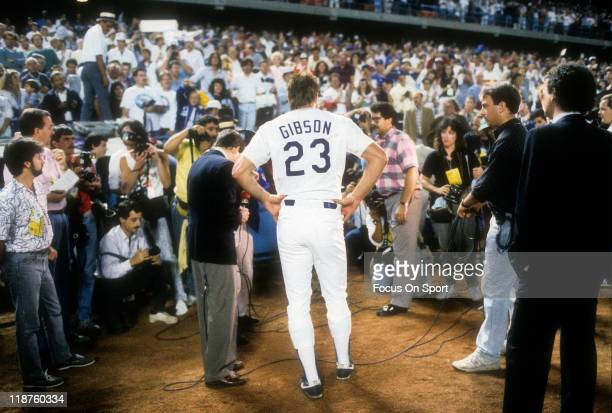 Kirk Gibson of the Los Angeles Dodgers talks with the media after hitting a game winning pitchhit home run in the bottom of the ninth inning of game...