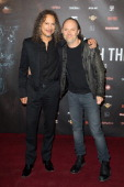 Kirk Hammet and Lars Ulrich attend the 'Metallica Through The Never' Paris Premiere at Le Grand Rex on October 8 2013 in Paris France