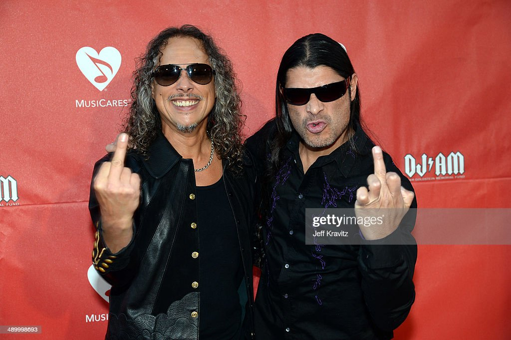 Kirk Hammett and Robert Trujilo arrives at the 2014 10th annual MusiCares MAP Fund Benefit Concert at Club Nokia on May 12, 2014 in Los Angeles, California.