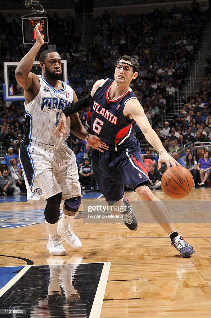 <a gi-track='captionPersonalityLinkClicked' href=/galleries/search?phrase=Kirk+Hinrich&family=editorial&specificpeople=201629 ng-click='$event.stopPropagation()'>Kirk Hinrich</a> #6 of the Atlanta Hawks drives to the basket against <a gi-track='captionPersonalityLinkClicked' href=/galleries/search?phrase=Gilbert+Arenas&family=editorial&specificpeople=201742 ng-click='$event.stopPropagation()'>Gilbert Arenas</a> #1 of the Orlando Magic in Game Five of the Eastern Conference Quarterfinals in the 2011 NBA Playoffs on April 26, 2011 at the Amway Center in Orlando, Florida.
