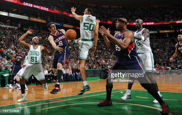 Kirk Hinrich of the Atlanta Hawks passes the ball against Erick Dampier of the Boston Celtics in Game Six of the Eastern Conference Quarterfinals...