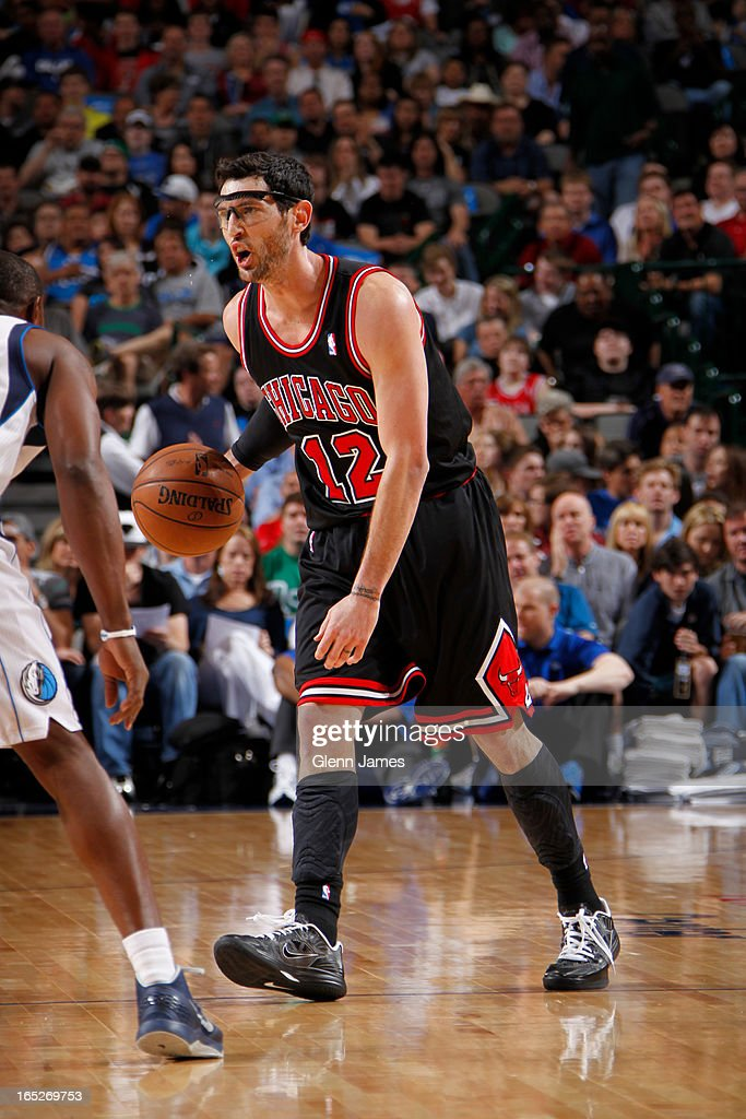 Kirk Hinrich #12 of the Chicago Bulls brings the ball up court against the Dallas Mavericks on March 30, 2013 at the American Airlines Center in Dallas, Texas.