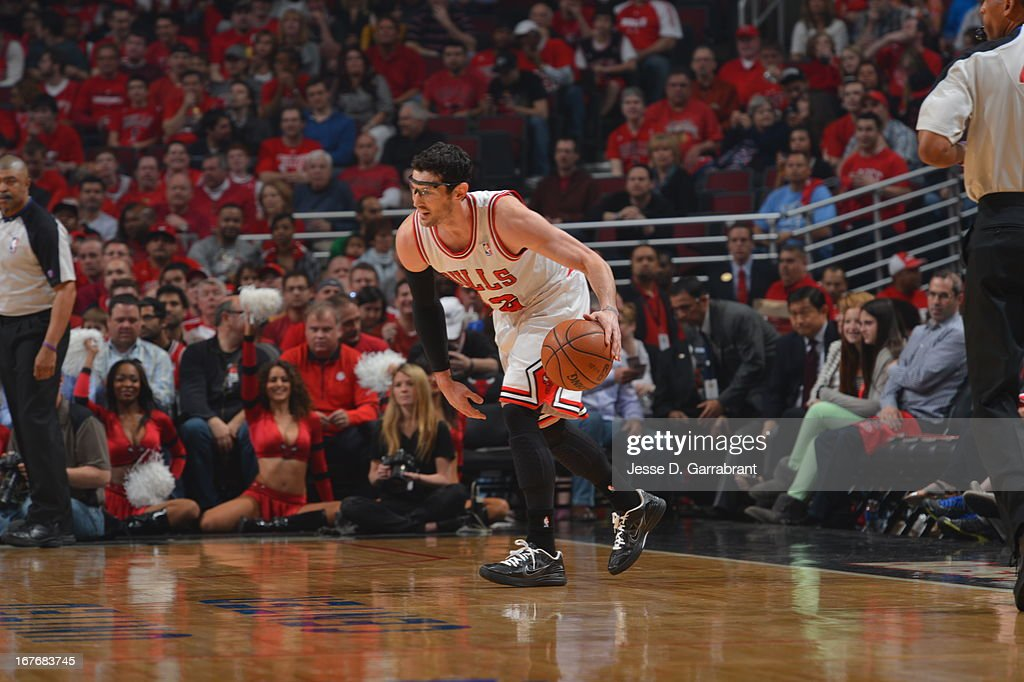 <a gi-track='captionPersonalityLinkClicked' href=/galleries/search?phrase=Kirk+Hinrich&family=editorial&specificpeople=201629 ng-click='$event.stopPropagation()'>Kirk Hinrich</a> #12 of the Chicago Bulls dribbles the ball against the Brooklyn Nets in Game Four of the Eastern Conference Quarterfinals during the 2013 NBA Playoffs on April 27, 2013 at United Center in Chicago, Illinois.