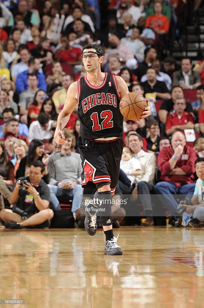 <a gi-track='captionPersonalityLinkClicked' href=/galleries/search?phrase=Kirk+Hinrich&family=editorial&specificpeople=201629 ng-click='$event.stopPropagation()'>Kirk Hinrich</a> #12 of the Chicago Bulls dribbles the ball upcourt against the Houston Rockets on November 21, 2012 at the Toyota Center in Houston, Texas.