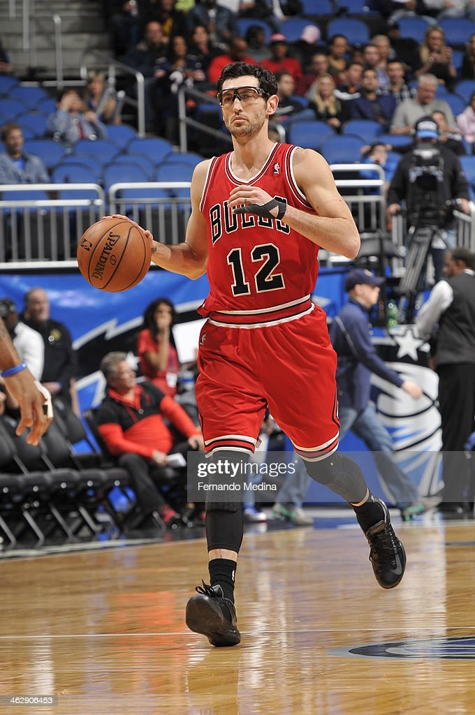 <a gi-track='captionPersonalityLinkClicked' href=/galleries/search?phrase=Kirk+Hinrich&family=editorial&specificpeople=201629 ng-click='$event.stopPropagation()'>Kirk Hinrich</a> #12 of the Chicago Bulls dribbles up the court against the Orlando Magic during the game on January 15, 2014 at Amway Center in Orlando, Florida.