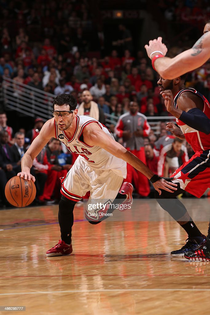 <a gi-track='captionPersonalityLinkClicked' href=/galleries/search?phrase=Kirk+Hinrich&family=editorial&specificpeople=201629 ng-click='$event.stopPropagation()'>Kirk Hinrich</a> #12 of the Chicago Bulls drives against the Washington Wizards during Game 1 of the Eastern Conference Quarterfinals on April 20, 2014 at the United Center in Chicago, Illinois.