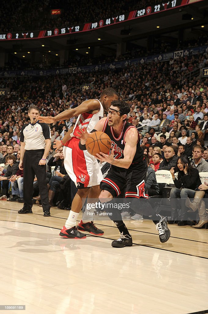 <a gi-track='captionPersonalityLinkClicked' href=/galleries/search?phrase=Kirk+Hinrich&family=editorial&specificpeople=201629 ng-click='$event.stopPropagation()'>Kirk Hinrich</a> #12 of the Chicago Bulls drives around defense of the Chicago Bulls during the game between the Toronto Raptors and the Chicago Bulls on January 16, 2013 at the Air Canada Centre in Toronto, Ontario, Canada.