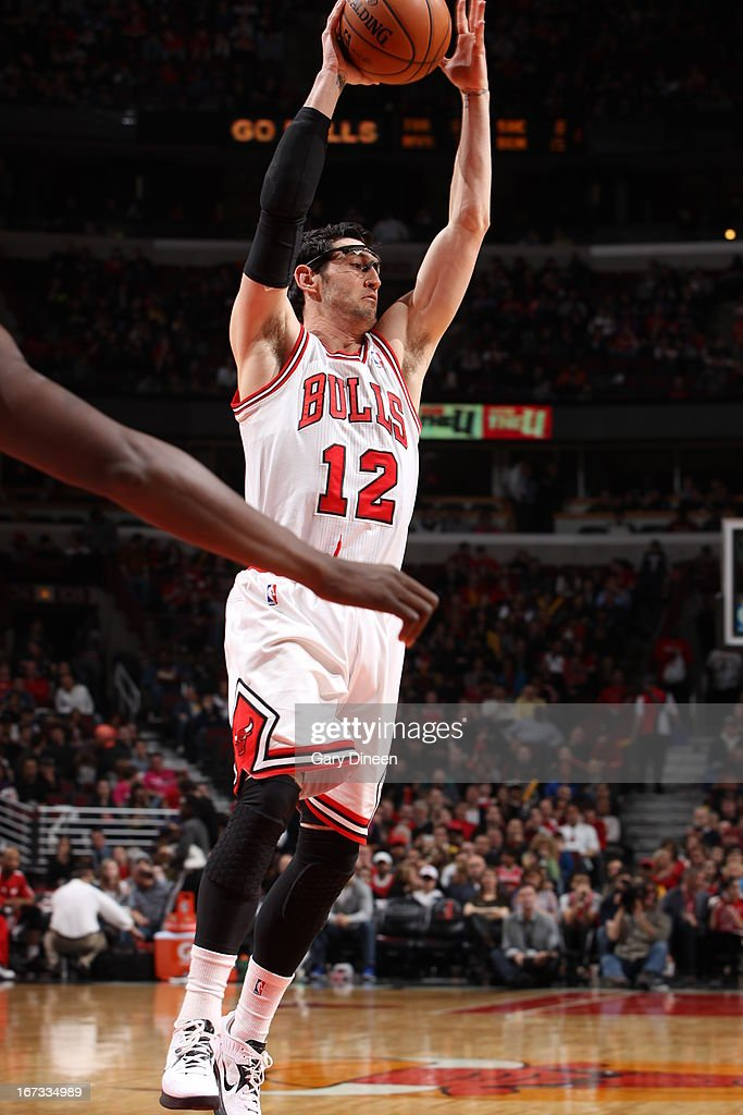 Kirk Hinrich #12 of the Chicago Bulls grabs a rebound against the Indiana Pacers on March 23, 2013 at the United Center in Chicago, Illinois.
