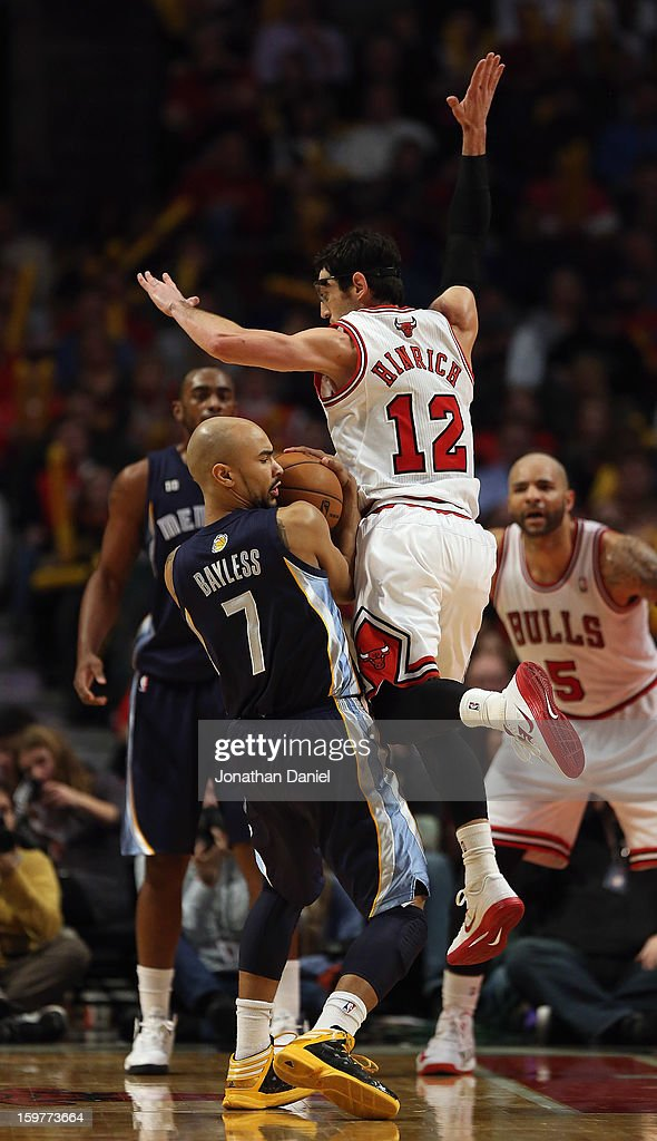 Kirk Hinrich #12 of the Chicago Bulls leaps to block Jerryd Bayless #7 of the Memphis Grizzles at the United Center on January 19, 2013 in Chicago, Illinois. The Grizzlies defeated the Bulls 85-82 in overtime.