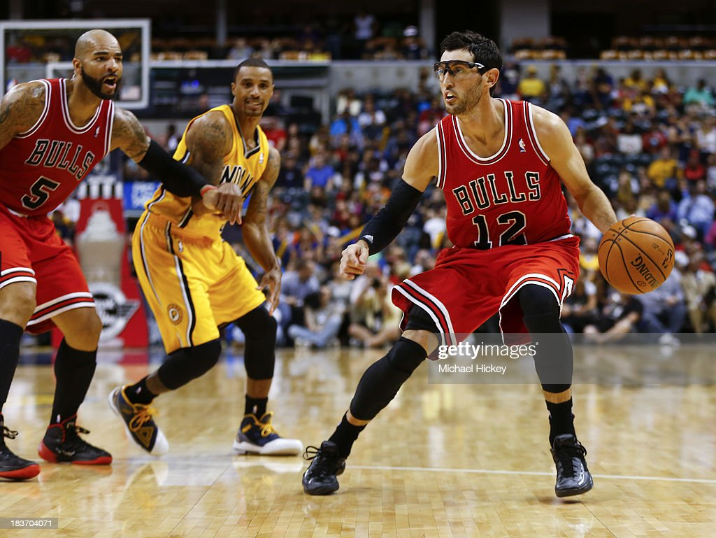 <a gi-track='captionPersonalityLinkClicked' href=/galleries/search?phrase=Kirk+Hinrich&family=editorial&specificpeople=201629 ng-click='$event.stopPropagation()'>Kirk Hinrich</a> #12 of the Chicago Bulls moves the ball during the game against the Indiana Pacers on October 5, 2013 at Bankers Life Fieldhouse in Indianapolis, Indiana. Chicago defeated Indiana 82-76.