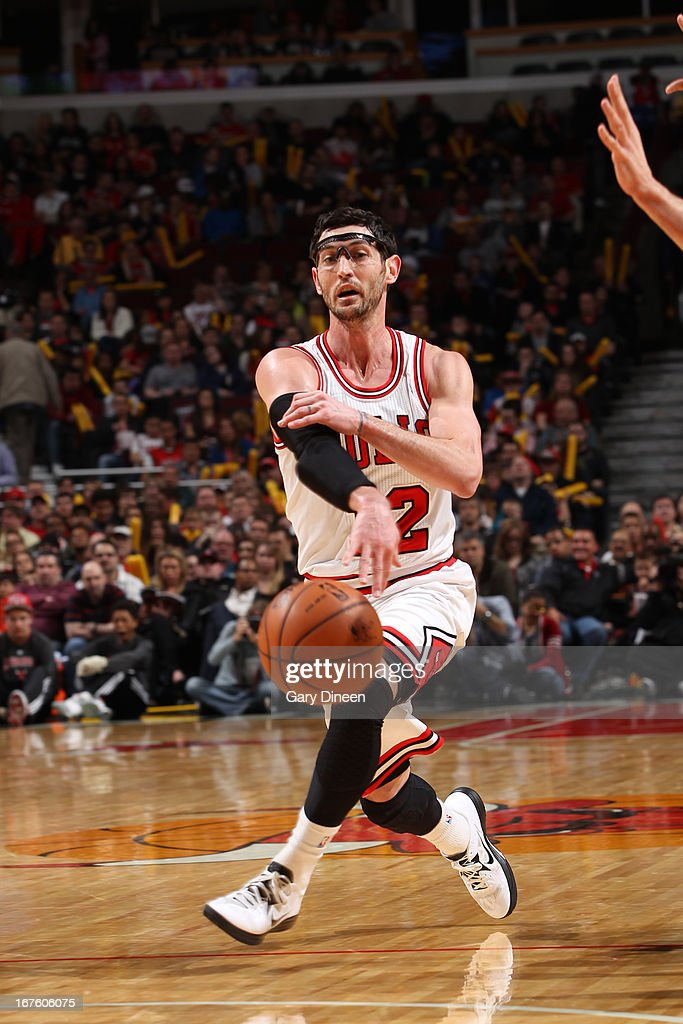 <a gi-track='captionPersonalityLinkClicked' href=/galleries/search?phrase=Kirk+Hinrich&family=editorial&specificpeople=201629 ng-click='$event.stopPropagation()'>Kirk Hinrich</a> #12 of the Chicago Bulls passes the ball down low against the Detroit Pistons on March 31, 2013 at the United Center in Chicago, Illinois.