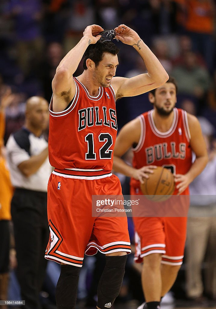 <a gi-track='captionPersonalityLinkClicked' href=/galleries/search?phrase=Kirk+Hinrich&family=editorial&specificpeople=201629 ng-click='$event.stopPropagation()'>Kirk Hinrich</a> #12 of the Chicago Bulls reacts after being called for a technical foul against the Phoenix Suns during the NBA game at US Airways Center on November 14, 2012 in Phoenix, Arizona. The Bulls defeated the Suns 112-106 in overtime.