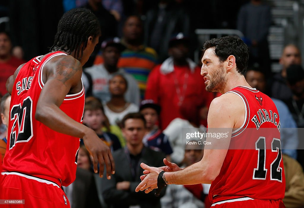 Kirk Hinrich #12 of the Chicago Bulls reacts with Tony Snell #20 after drawing a foul from Jeff Teague #0 of the Atlanta Hawks in the final seconds of their 107-103 win at Philips Arena on February 25, 2014 in Atlanta, Georgia.