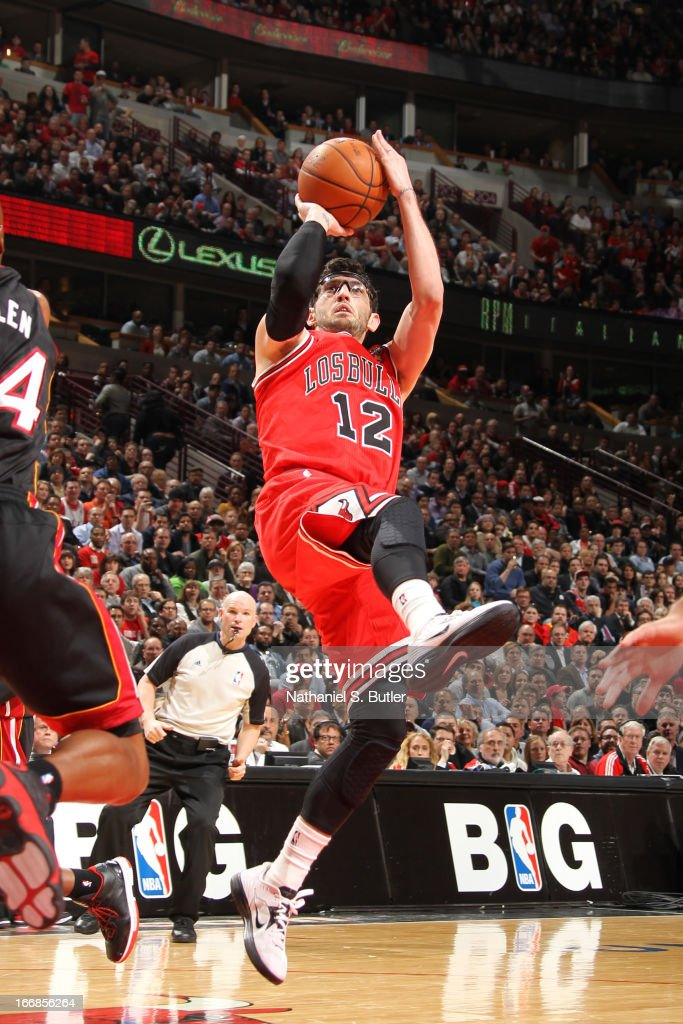 <a gi-track='captionPersonalityLinkClicked' href=/galleries/search?phrase=Kirk+Hinrich&family=editorial&specificpeople=201629 ng-click='$event.stopPropagation()'>Kirk Hinrich</a> #12 of the Chicago Bulls shoots a fade-away jumper against the Miami Heat Chicago Bulls on March 27, 2013 at the United Center in Chicago, Illinois.