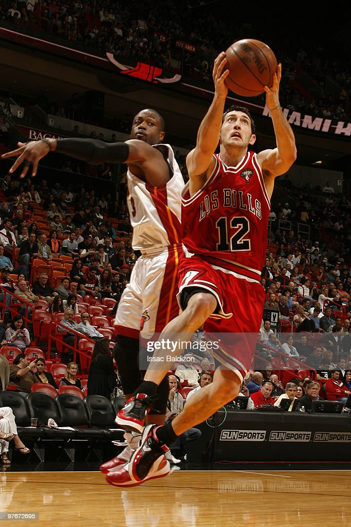 Kirk Hinrich #12 of the Chicago Bulls shoots against Dwyane Wade #3 of the Miami Heat on March 12, 2010 at American Airlines Arena in Miami, Florida.