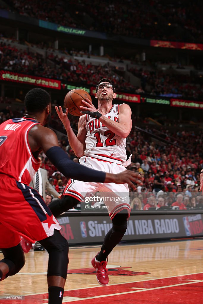 <a gi-track='captionPersonalityLinkClicked' href=/galleries/search?phrase=Kirk+Hinrich&family=editorial&specificpeople=201629 ng-click='$event.stopPropagation()'>Kirk Hinrich</a> #12 of the Chicago Bulls shoots against the Washington Wizards during Game 1 of the Eastern Conference Quarterfinals on April 20, 2014 at the United Center in Chicago, Illinois.