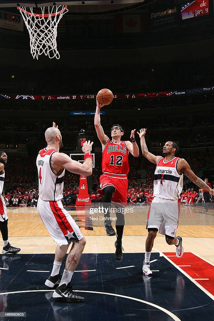 # <a gi-track='captionPersonalityLinkClicked' href=/galleries/search?phrase=Kirk+Hinrich&family=editorial&specificpeople=201629 ng-click='$event.stopPropagation()'>Kirk Hinrich</a> #12 of the Chicago Bulls shoots against the Washington Wizards in Game Three of the Eastern Conference Quarterfinals during the 2014 NBA Playoffs at the Verizon Center on April 25, 2014 in Washington, DC.