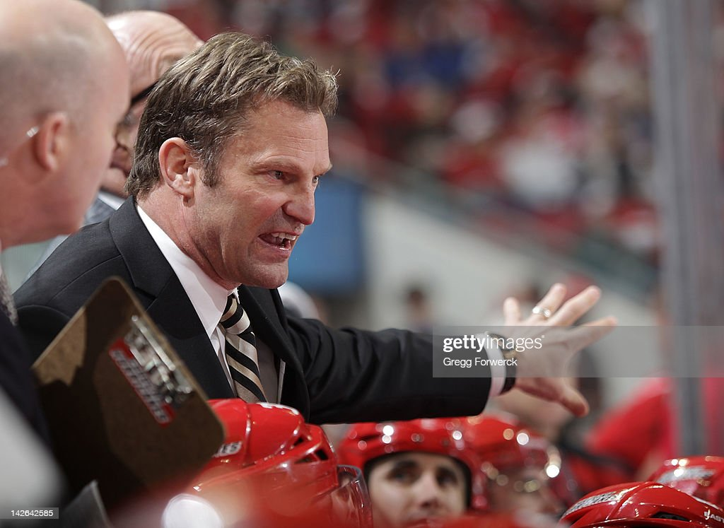 Kirk Muller head coach of the Carolina Hurricanes instructs his team during a timeout of an NHL game against the Montreal Canadiens on April 5, 2012 at PNC Arena in Raleigh, North Carolina.