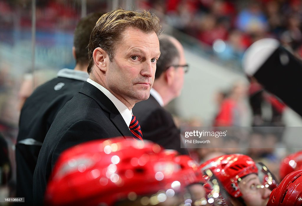 Kirk Muller of the Carolina Hurricanes looks out onto the ice during an NHL game against the Pittsburgh Penguins on February 28, 2013 at PNC Arena in Raleigh, North Carolina.
