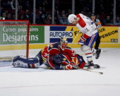 Kirk Muller of the Montreal Canadiens looks for a loose puck near the net against the Florida Panthers Circa 1990 at the Montreal Forum in Montreal...