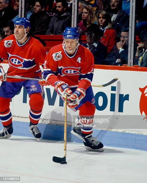 Kirk Muller of the Montreal Canadiens skates with the puck Circa 1990 at the Montreal Forum in Montreal Quebec Canada