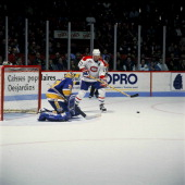 Kirk Muller of the Montreal Canadiens watches the puck after a shot on goal during a game against the St Louis Blues Circa 1990 at the Montreal Forum...