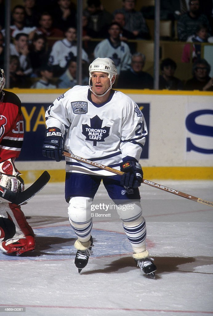 <a gi-track='captionPersonalityLinkClicked' href=/galleries/search?phrase=Kirk+Muller&family=editorial&specificpeople=221687 ng-click='$event.stopPropagation()'>Kirk Muller</a> #21 of the Toronto Maple Leafs skates on the ice during an NHL game against the New Jersey Devils on December 10, 1996 at the Maple Leaf Gardens in Toronto, Ontario, Canada.