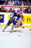 Kirk Muller of the Toronto Maple Leafs skates with the puck during an NHL game against the Detroit Red Wings on November 2 1996 at the Maple Leaf...
